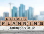 Estate Planning during COVID-19 on wood blocks with city in background Massachusetts